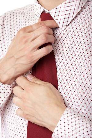 knotting: Close-up photo of the businessman knotting his red necktie