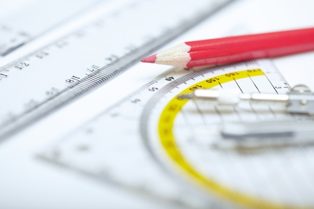 depth measurement: Red pencil with compasses and rulers on a paper. Extremely close-up photo Stock Photo