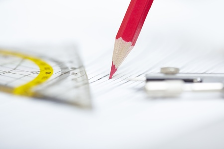 Drawing tools on a paper. Extremely close-up photo with shallow depth of field