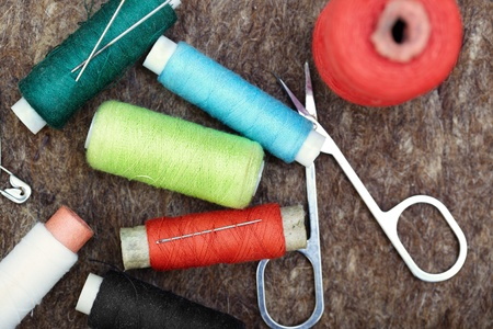 stitching: Sewing tools on a woolen fiber. Close-up color photo