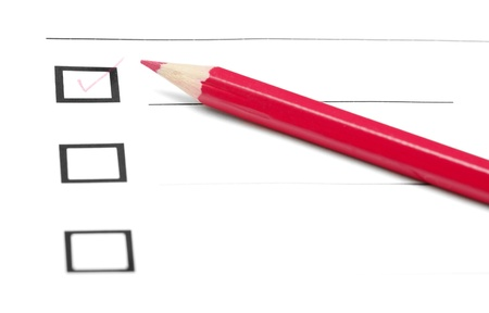 Red pencil on a inquiry form with checkboxes photo