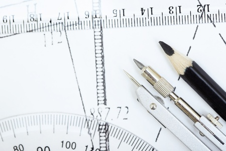 protractor: Scheme with compasses rulers and pencil. Close-up
