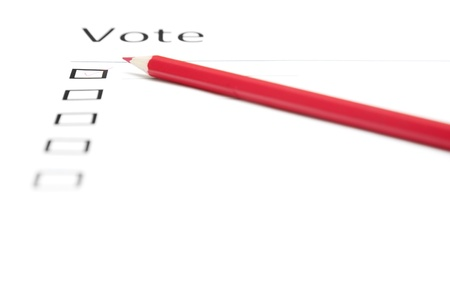 electorate: Voting bulletin with red pencil to make choice