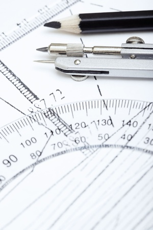 protractor: Scheme with compasses rulers and pencil. Extremely close-up photo Stock Photo