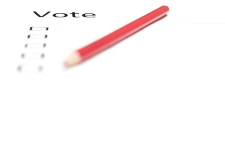 Voting bulletin with red pencil to make choice photo