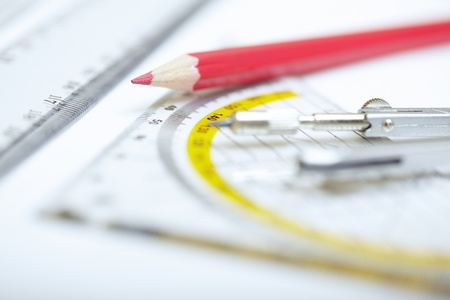 Red pencil with compasses and rulers on a paper. Extremely close-up photo Stock Photo - 13571829