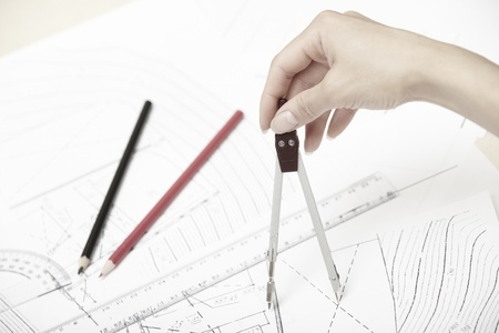protractor: Hand of engineer working on a construction plan Stock Photo