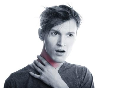 Man suffering from pain in throat. Studio photo photo