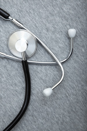 cardiosurgery: Medical stethoscope on a textured background. Close-up photo Stock Photo