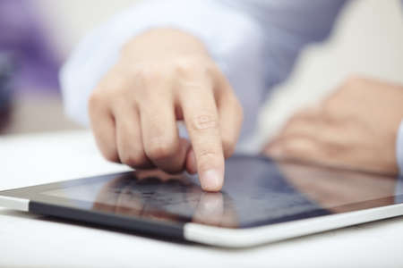 body writing: Hands of businessman using tablet PC at office