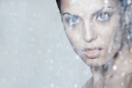 bathroom women: Attractive lady behind the water falling Stock Photo