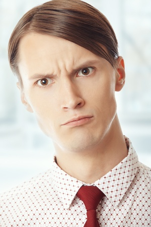 Displeased businessman at his office. Vertical portrait Stock Photo - 14737272
