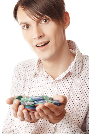 Glad man holding casino chips on a white background Stock Photo - 14737274