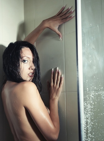 recreate: Wet lady in shower cabin Stock Photo