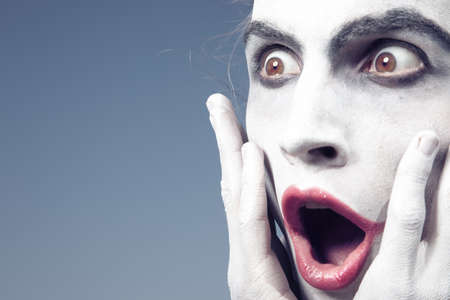 Man with white makeup expressing shock Stock Photo - 15408323
