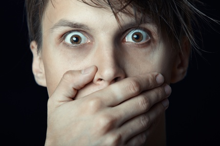 Man covering his mouth by the hand