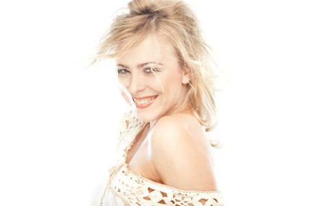 mirth: Laughing blond lady on a white background