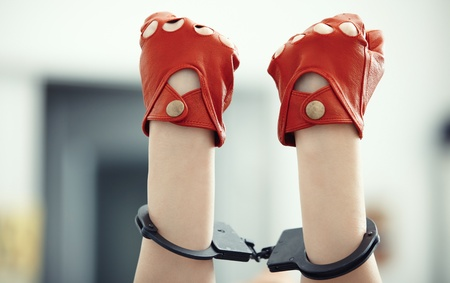 apprehension: Two human hands in wristlets. Horizontal photo