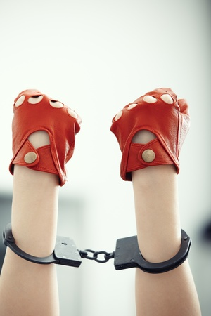 Two human hands in wristlets. Vertical photo Stock Photo - 15810730