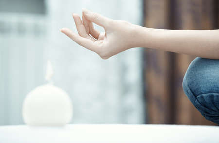 meditation room: Hand of human practicing yoga at home