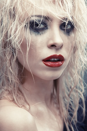 Blond lady with strange makeup. Vertical photo photo