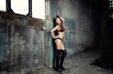 Sensual lady in lingerie standing posing in the industrial place photo