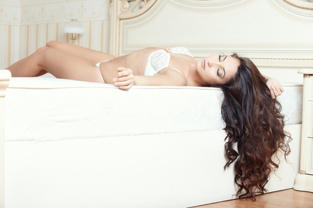 Attractive lady lying and sleeping in bedroom Stock Photo - 17213764