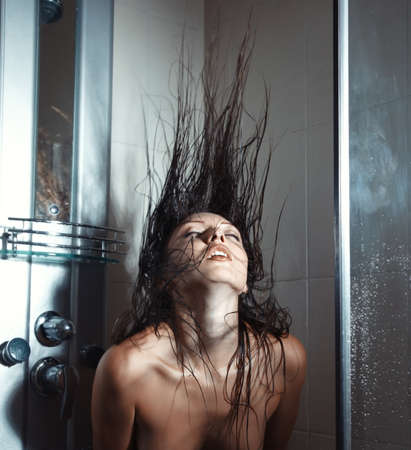 Woman in bathroom moving hairs Stock Photo - 17540172