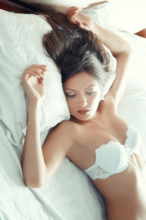 Pretty lady in lingerie laying on the bed Stock Photo - 17540171
