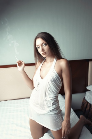 Woman with cigarette at home Stock Photo - 17540170