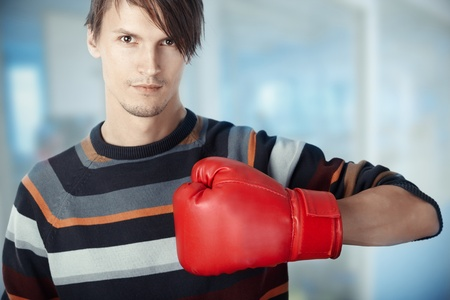 muffle: Man at the office with boxing glove. Horizontal photo