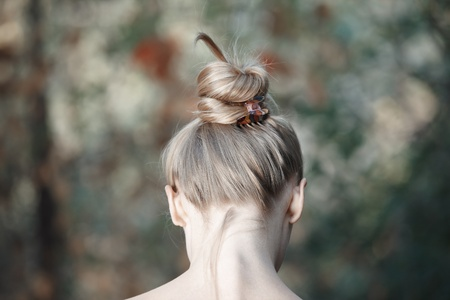 Rear view on the head of young woman outdoors