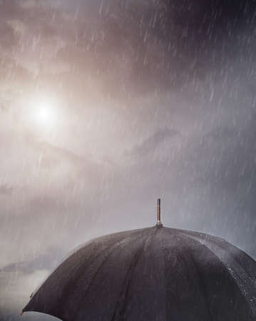 Wet umbrella under the rain photo