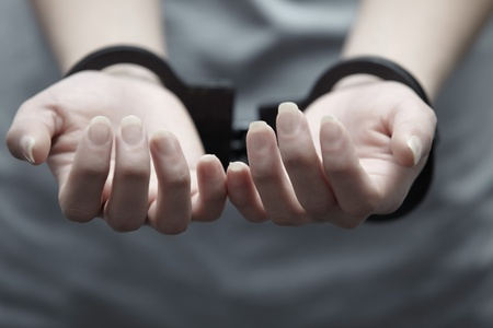 wristlets: Human hands in handcuffs. Close-up horizontal view