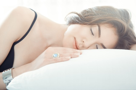 armlet: Brunette lady with jewelry sleeping on the bed