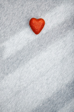 fondness: Red heart of love on a textured background with shadows