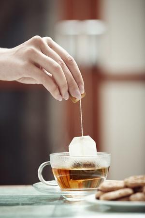 teabag: Human hands making tea
