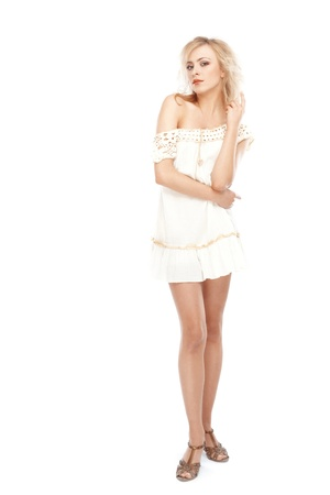 Blond woman in dress posing on a white background photo