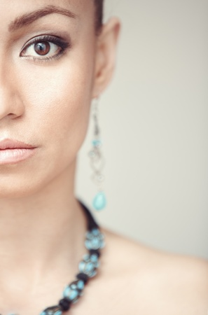 Woman with blue jewelry. Vertical photo photo