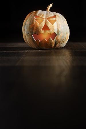 nightmarish: Halloween Pumpkin  latnern in the dark room Stock Photo