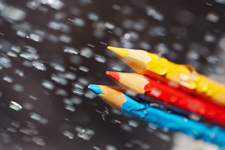 rainfall: Three color pencils under the rain. Close-up view