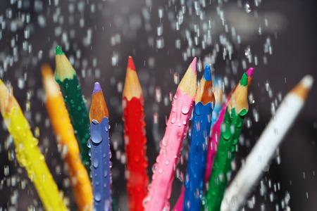 variability: Color pencils under the rain. Close-up view