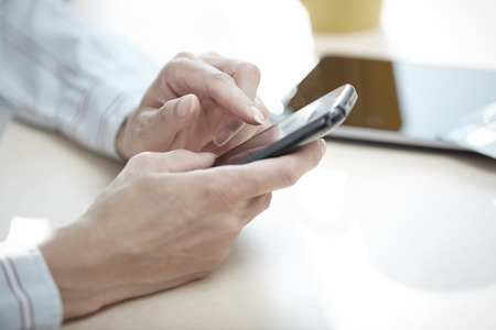 chat online: Hands of smartphone user at lunch
