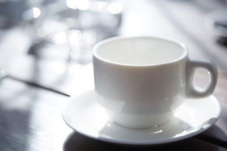 replenishment: Teacup on the table at outdoors cafe Stock Photo