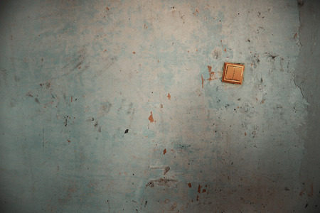 parget: Old switch on the damaged wall. Horizontal photo Stock Photo