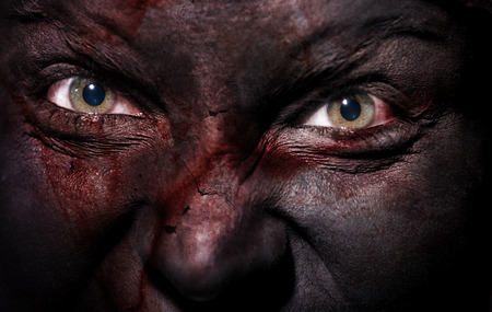 beldam: Close-up view on evil witch with bloody black skin Stock Photo