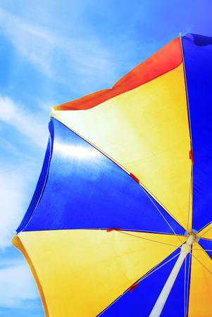 yellow umbrella: Close-up photo of the beach umbrella on blue sky Stock Photo
