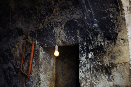 industrial ruins: Lamp in abandoned house. Horizontal photo
