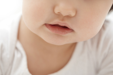 boyhood: Mouth of the child. Close-up horizontal photo