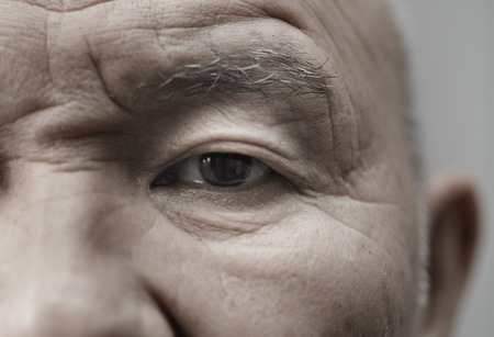 Face of elderly man looking at camera. Horizontal photo Stock Photo